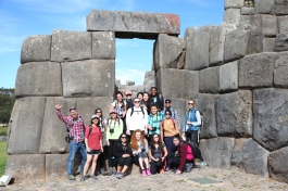 The group pauses for a photo among some of the largest rocks used in Inca construction.