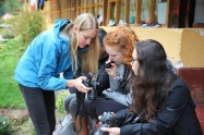 Erika shares pro video tips with students prior to recording interviews at the Munaychay orphanage. (Photo: J.Lambert)