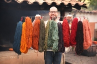 Brock holds examples of naturally dyed fiber ready for spinning. (Photo: JLambert)